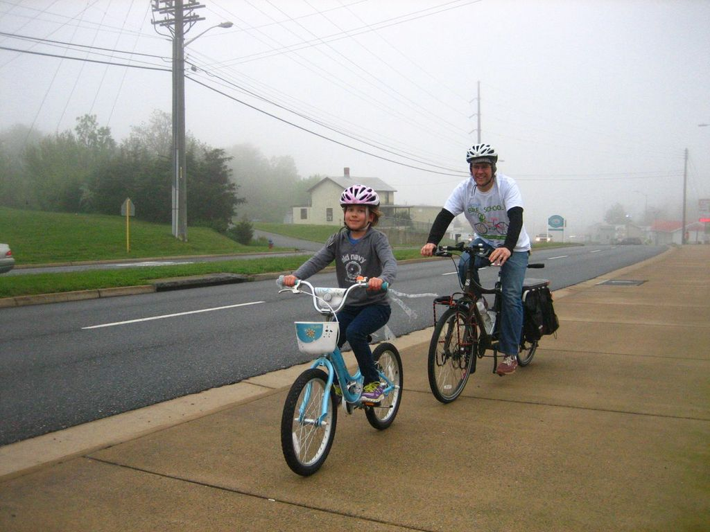 Trent Wagler and his daughter Maya ride to school
